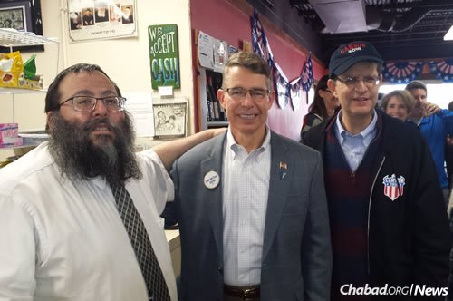 From left: Rabbi Yossi Jacobson with retired Maj. Gen. Robert F. Dees and Dr. Mark Young, supporters of Republican presidential candidate Ben Carson