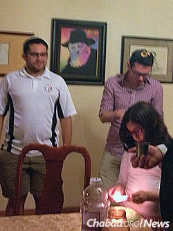 Volunteers supporting Democratic presidential candidate Hillary Clinton celebrate Havdalah with the Jacobsons at the end of a recent Sabbath.