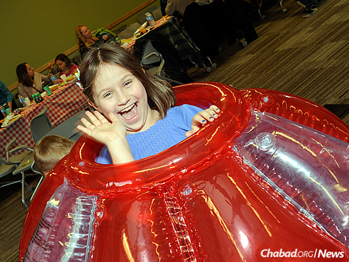 """Having a blast in a """"human hamster ball"""" at a Lag B'Omer family event."""