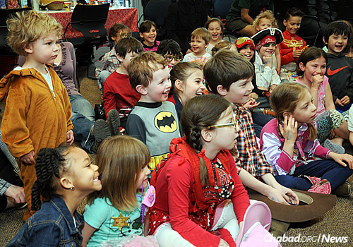 """Children enjoy entertainment at a Purim event. This year's theme is """"Purim in the Stadium,"""" which just so happens to follow on the heels of the Denver Broncos' win at the Super Bowl."""