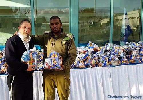 Bags of snacks to be distributed to Israeli soldiers, organized by Chabad of Kiryat Arba.
