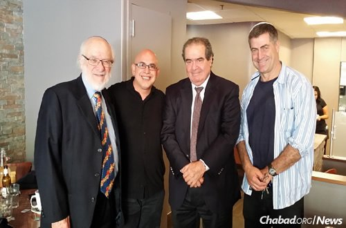 Nathan Lewin, left, and Supreme Court Justice Antonin Scalia, third from left, with restaurant owners Sima Soumekhian and Marc Zweben in Washington, D.C. (Photo: Alyza Lewin)