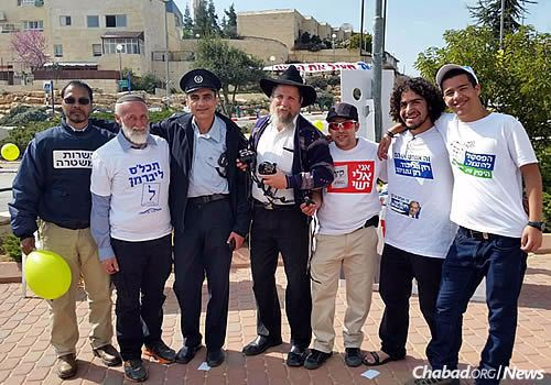 Nachshon at center: For more than 20 years, the rabbi and his family have been living and working to spread the Torah's teachings in the Givat Harsina neighborhood of Kiryat Arba, where they have become an integral part of the community.