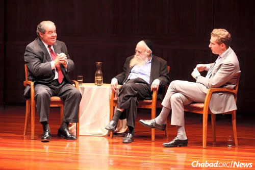 Justice Antonin Scalia, left, with Rabbi Adin Even-Israel (Steinsaltz) at a 2014 dialogue at the Jewish Heritage Museum in New York, moderated by Professor Noah Feldman, right, of Harvard Law School. (Photo: Aleph Society)