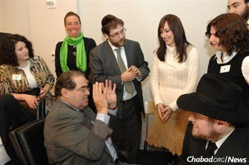 Scalia with students and Rabbi Noach Heber, center, program director, and Rabbi Yehoshua Metzger, right, co-director of Chabad Lubavitch of Midtown Manhattan, at a 2009 daylong conference of the Institute of American and Talmudic Law held at the Chabad center.