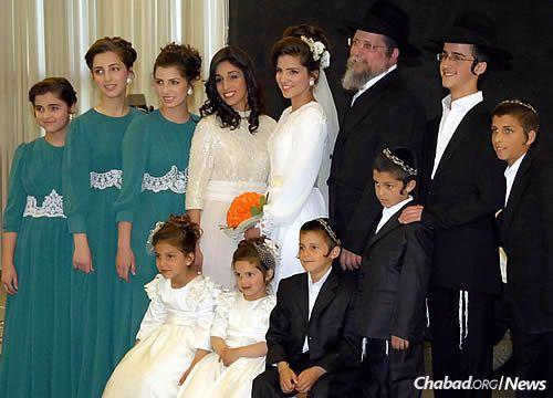 Rabbi Yossi and Michal Nachshon, and their family