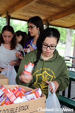 "Girls volunteer and pack food boxes in Grand Junction, Colo., on ""CTeen Xtreme."""