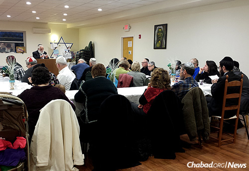 """Rabbi Yisroel Rubin of Albany, N.Y., marks a milestone with a group of Jews in Kingston, N.Y., who recently completed the study of the entire """"Kitzur Shulchan Aruch,"""" the popular abridgement of the """"Code of Jewish Law."""""""
