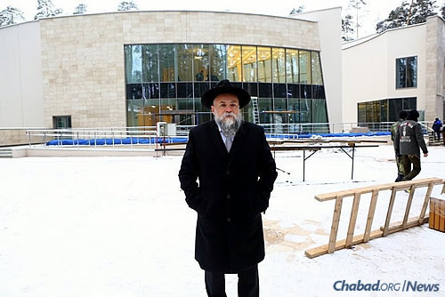 Rabbi Alexander Barada stands in front of the Zhukovka Jewish Community Center, which opened in December. He also serves as president of the Federation of Jewish Communities of Russia.