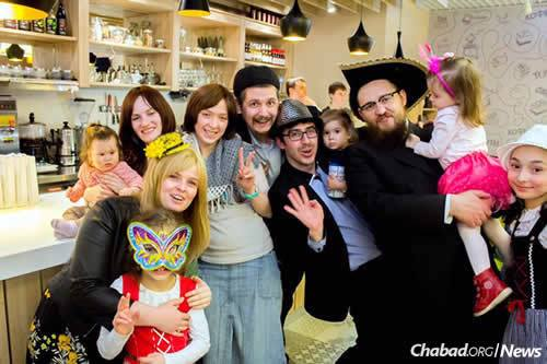 Purim at Chabad on Michurinskiy, one of a handful of Chabad centers that opened this year in Moscow. It's led by Rabbi Shimon Krasnodomskiy, far right, and his wife, Chana, front left.