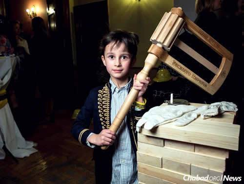 A child holds an oversized grogger at the International Jewish Community of Moscow's annual Purim party. A total of 28 Chabad centers now dot the Russian capital. (Photo: International Jewish Community of Moscow)
