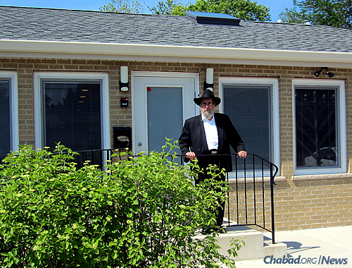Rabbi Binyomin Scheiman outside his Illinois Chabad House, which serves the Jewish communities of Niles and Des Plaines.