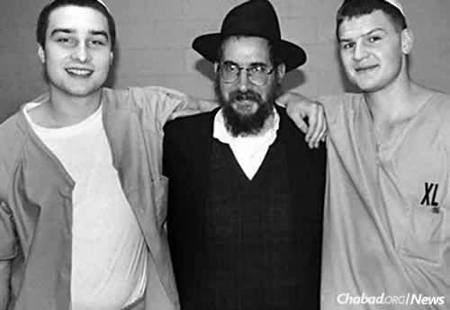 Rabbi Binyomin Scheiman, who has been visiting prisons since 1980, with two young incarcerated men.