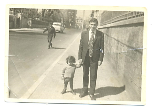 Yom Tov Gindi walks with a nephew in Syria.
