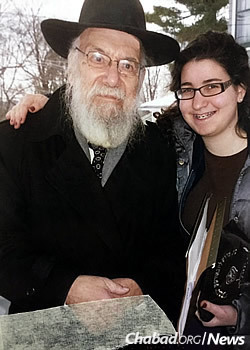 Bracha Kosofsky distributed shmurah matzah with her grandfather a few years before his passing at age 90.