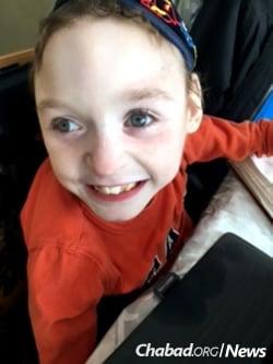 Meir Samuels, 7, cannot walk or talk.