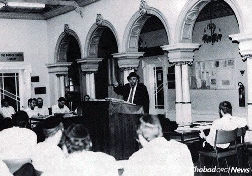 At the podium is Rabbi Chaim Gutnik, a leading Australian rabbi and among the founders of the Rabbinical College, giving a class at the yeshivah.