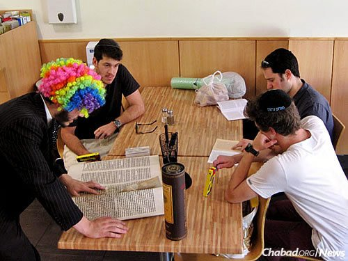 An ad hoc Megillah reading at a restaurant.