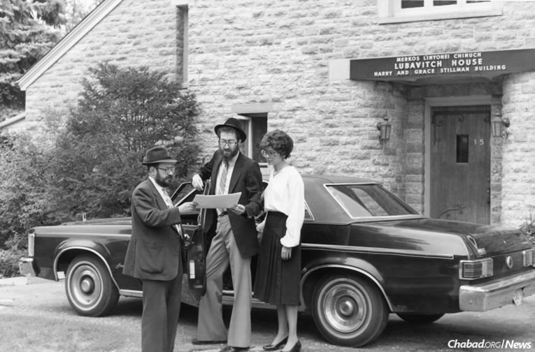 Rabbi Moshe Feller, left, outside Lubavitch House at 15 Montcalm Court, where Bais Chana—the world-renowned educational institute for women—was born.
