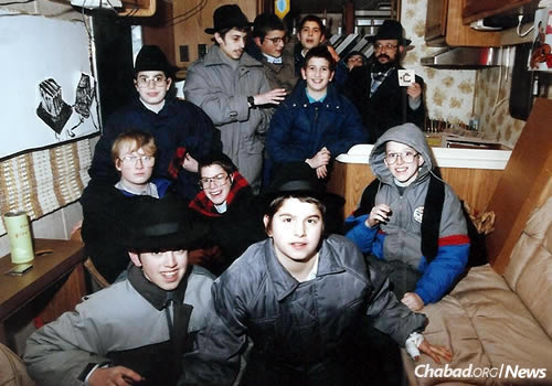 """Feller with a group of Cheder students in a """"mitzvah tank,"""" getting ready to bring a little Jewish warmth into the Minnesota cold."""