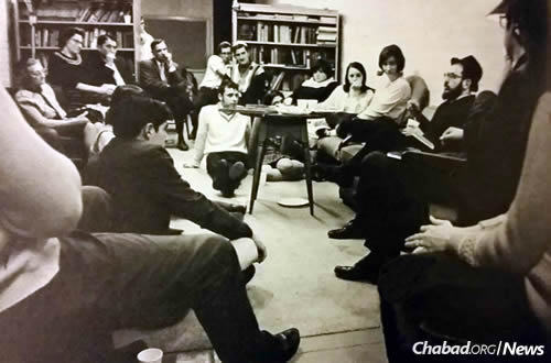 The rabbi holds a conversation with young adults in Minnesota.