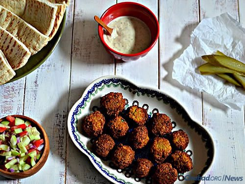Recipes are a popular feature, especially traditional family ones and those with a Middle Eastern flair, like this dish consisting of Crunchy Homemade Falafel with Hummus, Tahini and Israeli Salad.