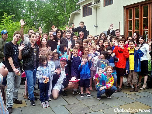 Jewish residents of Short Hills enjoy Lag BaOmer festivities held by the Solomon family.