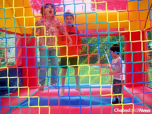 Entertainment for children at outdoor events for the holiday often includes a moonbounce.