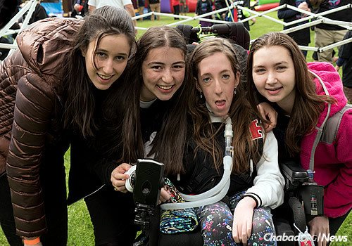 """Finkelstein takes time out for a photo with friends at the """"Walk 4 Friendship"""" event in May. (Photo: Gary Rabenko)"""