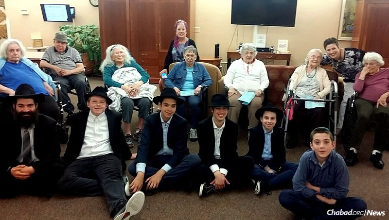 """Throughout the school year, five students have visited seniors at an assisted-living facility in Portland, Ore., each week as part of a program called """"Torah & Us."""" From left, bottom row, are: Rabbi Shneur Wilhelm, principal of Maimonides Jewish Day School and the boys' teacher; Noach Both, Menachem Wilhelm, Ari Becker, Mendel Greenberg and Shmuel Dovid Mishulovin."""
