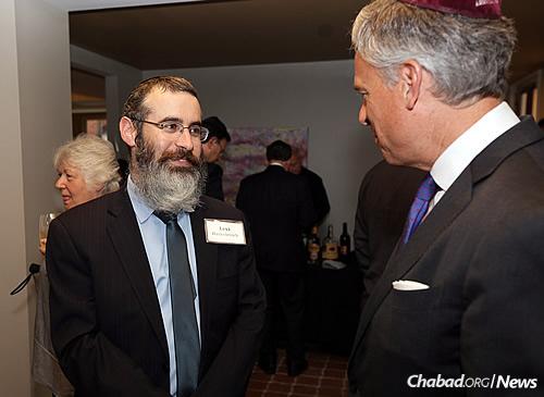 Rabbi Levi Haskelevich, left, with keynote speaker Jon Huntsman Jr., himself a graduate of Penn (Photo: Marc Smiler)