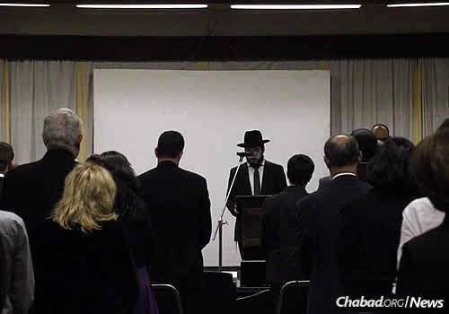 Rabbi Super speaks at a Holocaust memorial held at the Nairobi Jewish community's Vermont Hall, which sits within the Nairobi Hebrew Congregation's complex.