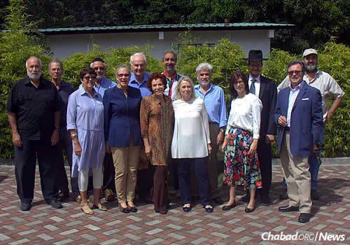 """About 100 Jewish families reside in Boquete year-round, with many more """"snowbirds"""" visiting during the winter. Rabbi Yakov and Hana Poliwoda stand second from right."""