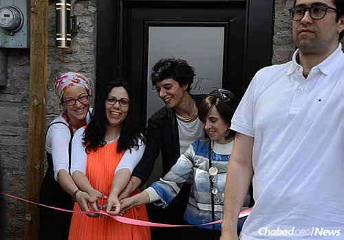 Cutting the (appropriately) pink ribbon are, from left, Noemie Stanleigh; Devorah Leah Lewin, co-director of the Chabad House with her husband; and Fanny Levy-Henon (Photo: Louis Philippe Faucher)