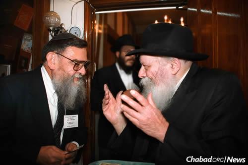 Dr. Velvl Greene, left, with the Rebbe—Rabbi Menachem M. Schneerson, of righteous memory