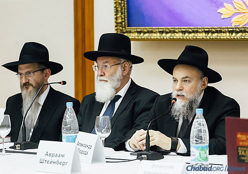 Rabbi Alexander Barada, right, president of the FJC, speaks about the project at the youth forum. Next to him is medical ethicist Rabbi Dr. Avraham Steinberg and, at left, Rabbi Berel Lazar, the chief rabbi of Russia.