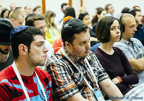 Attendees listen to the announcement of the project at last month's youth forum. Publishing the Talmud, a foundational text in Jewish life, was forbidden during Communist rule in Russia.