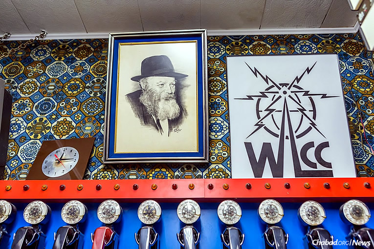 WLCC's logo, as seen in the room today (Photo: Eliyahu Yosef Parypa/Chabad.org)