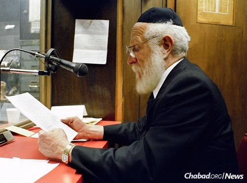 """Rabbi JJ Hecht talks on the radio in WLCC's office, March 1989. The show was broadcast on """"The Forward's"""" WEVD station. (Photo: JEM/The Living Archive)"""