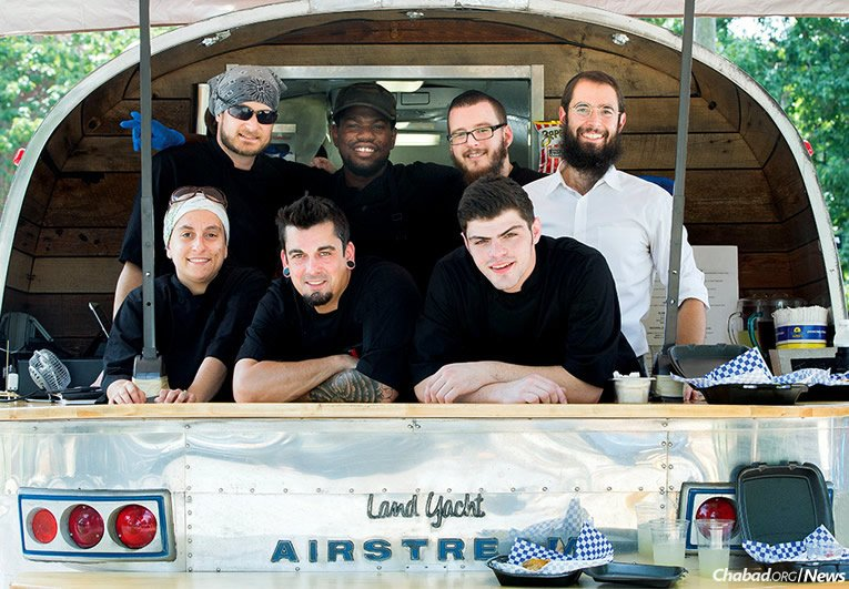The cooking crew at Aryeh's Kitchen, led by 21-year-old Zack Freeling, bottom row, far right. Freeling father's, Ken, and Rabbi Shlomo Rothstein, top row, right, worked together to establish a full-service kosher food truck at Vanderbilt University in Nashville, Tenn. (Photo: Courtesy of Vanderbilt University/Susan Urmy)