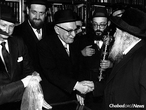 Israeli President Zalman Shazar is greeted by Rabbi Shmuel Levitin in the Rebbe's office during the former's 1971 visit to the Rebbe. Cohen, to the immediate left of Shazar, was a member of the Israeli delegation. (Photo: JEM/The Living Archive)