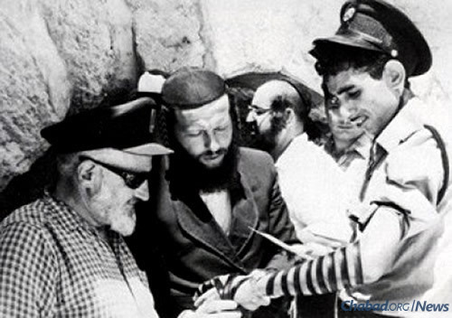 Wrapping tefillin in Old City Jerusalem, with Jewish access renewed as a result of the 1967 Six-Day War.