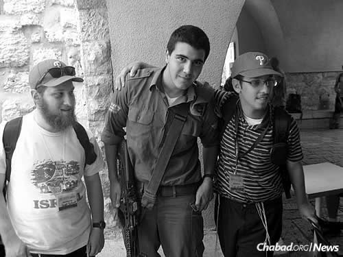 Yossi and Laible Schmidt with an Israeli soldier in the Old City of Jerusalem