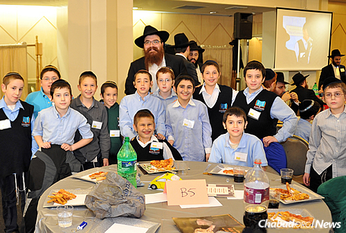 "Rabbi Mendel Levin's class at ""A Day of Celebration,"" held for boys and girls around the time of annual emissary conferences in New York. Students have the opportunity to spend quality time, in person, with their teachers; parents get to meet them, too."