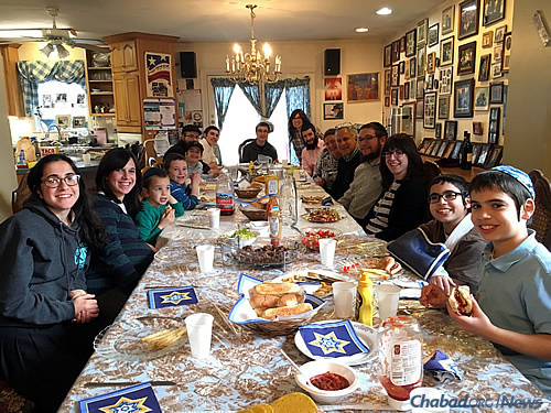 Some of the local Weinstein children and grandchildren gather for a weekly family dinner. Students are often invited for all kinds of meals, not just on Shabbat.