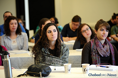 The data suggests that those with moderate and high levels of participation in Chabad come closer to the mainstream Jewish community in the post-college years. (Photo: Chabad on Campus International)