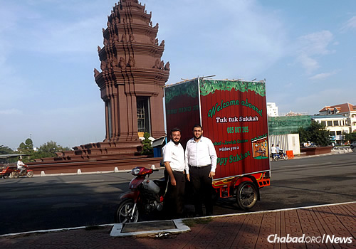 Driving a mobile sukkah around Phnom Penh, which blends into the slew of motorbikes and other open-air vehicles in the city.