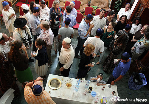 People of all ages, including many young professionals, participate in social events with Chabad.
