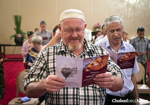 At the 2012 ceremony dedicating a new Torah for the Chabad House (Photo: Nick Sells)
