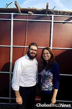 Rabbi Levi and Mushky Dubov, co-directors of Chabad of Bloomfield Hills, Mich., in their finished sukkah